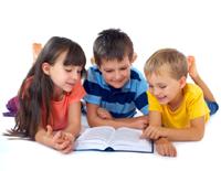 Children enjoying reading a book