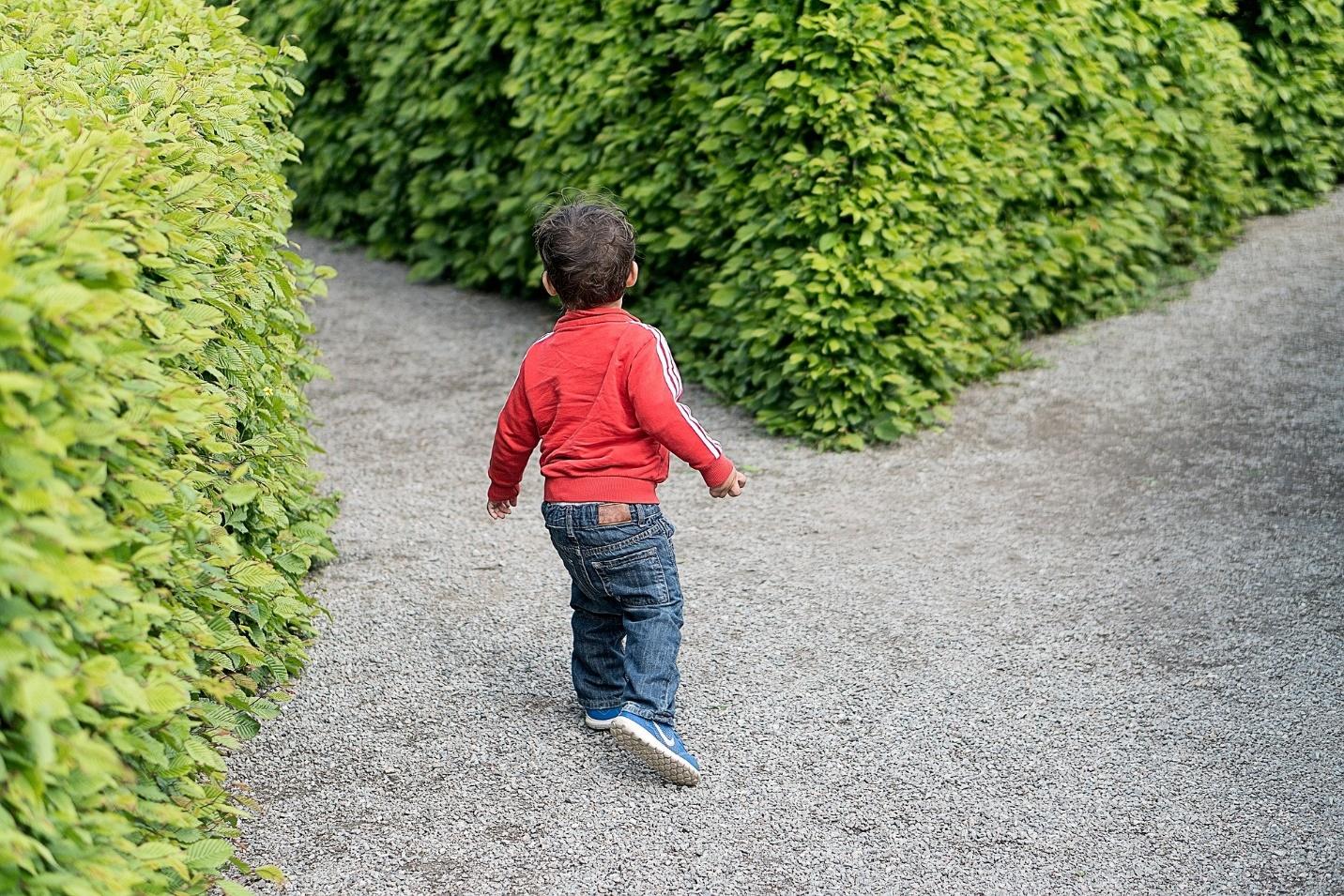 Boy running in a maze